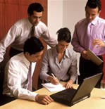Picture of people working together in a corporate setting