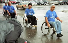 People in wheelchair going